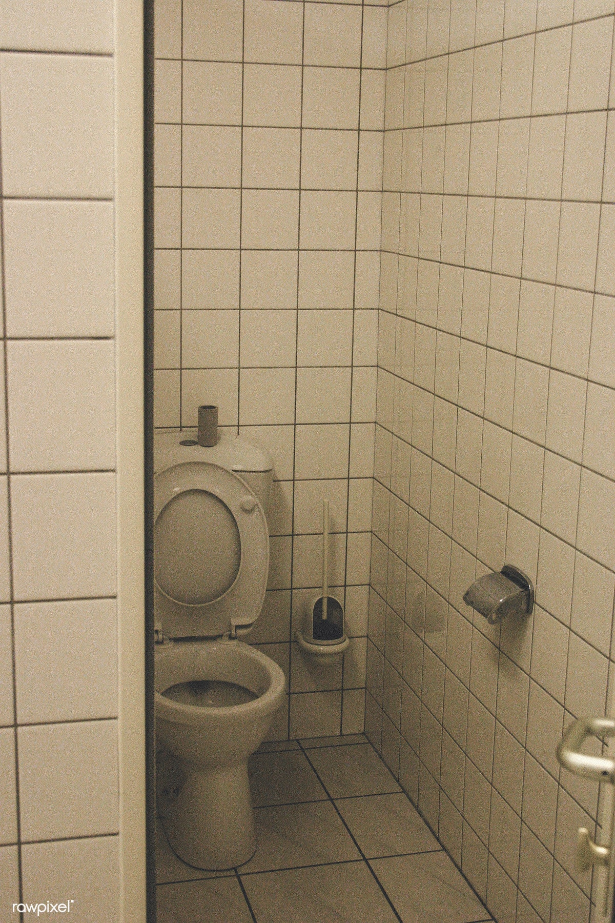Toilet With White Tiles All Over