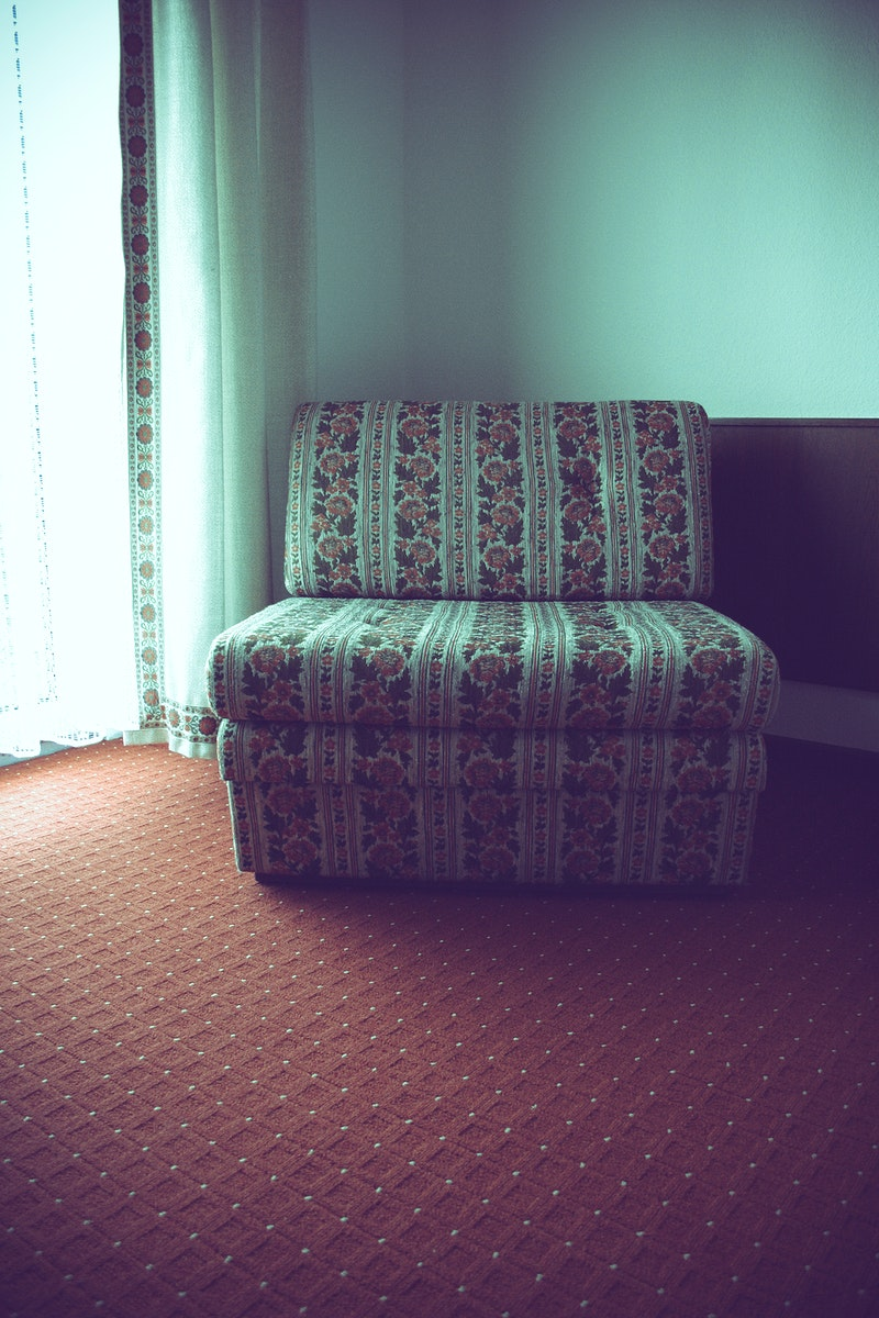 Floral upholstered chair in a room