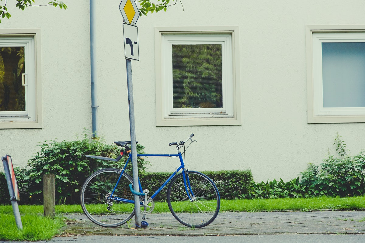 Bike chained to a street sign
