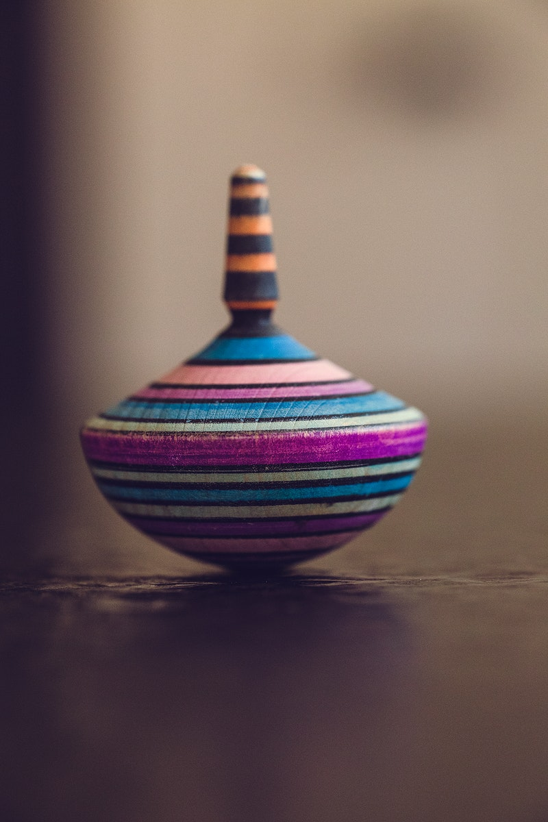 Multi-colored spinning top