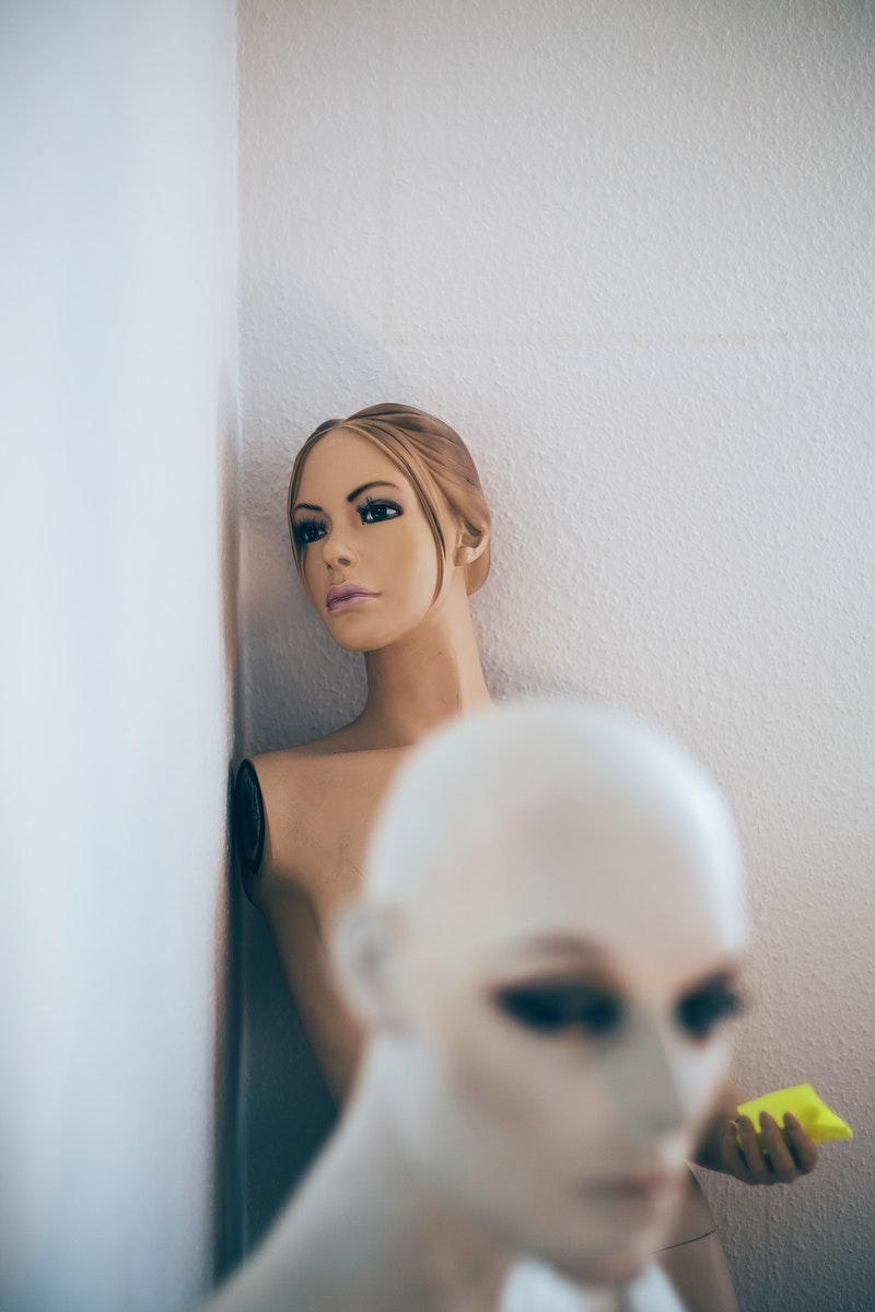 Lifelike mannequins in a storage room