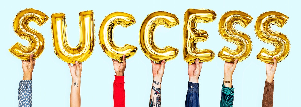 Hands showing success balloons word