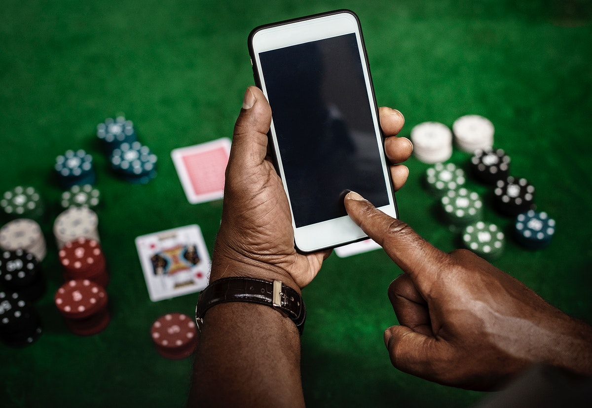 Gambling background and a smartphone with an empty screen