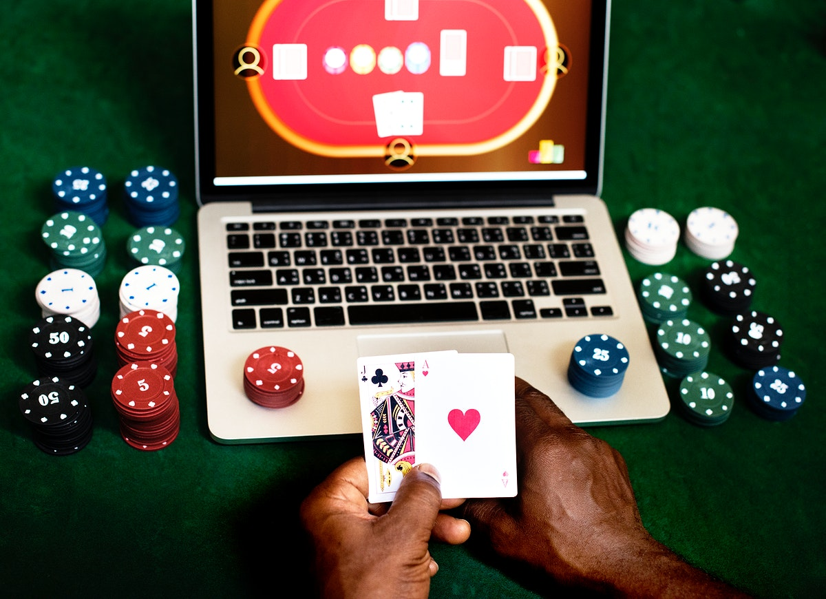 Hand holding card playing online gambling