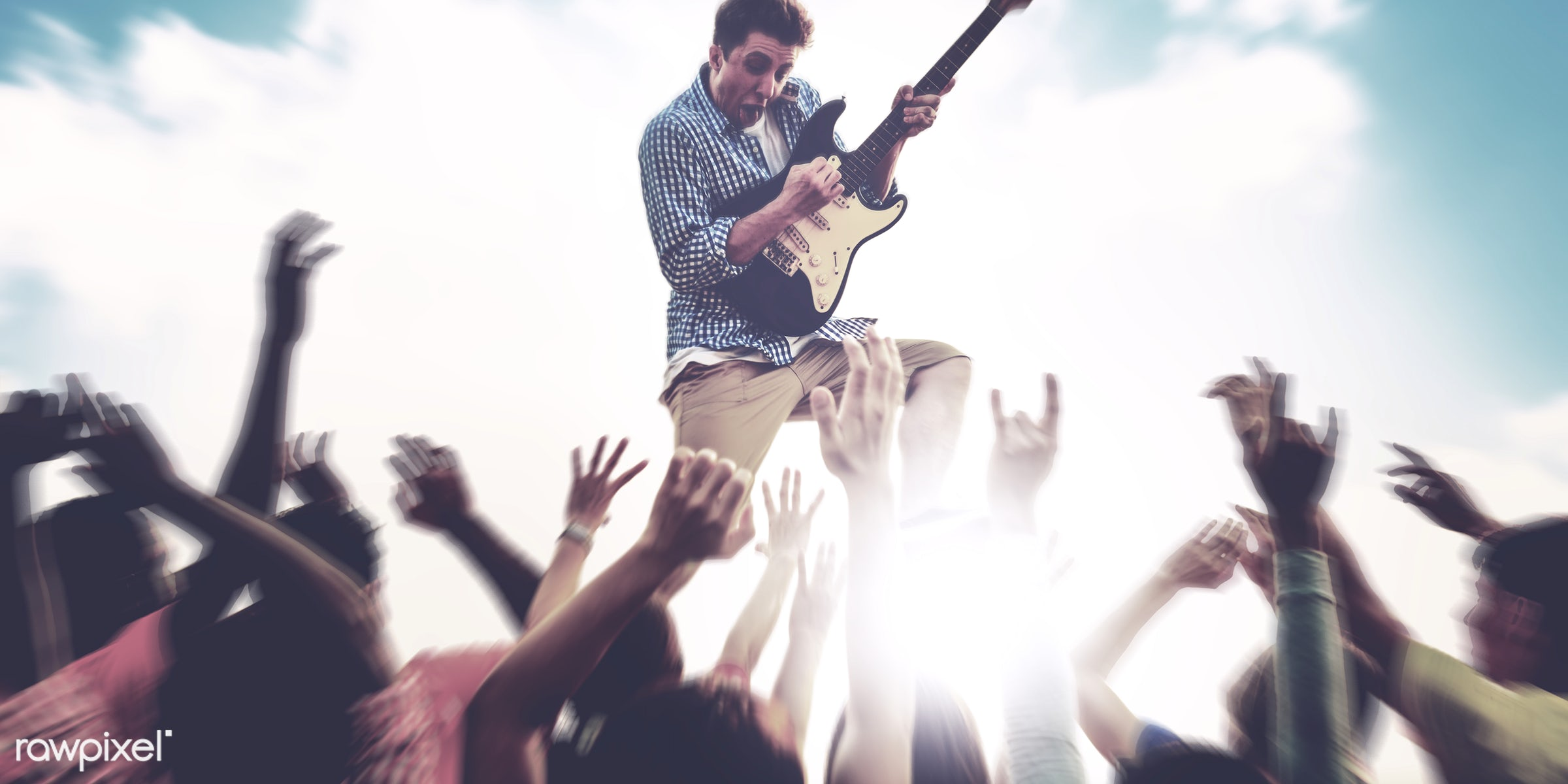 Guitarist playing at a music festival - concert, beach party, guitar, adolescence, audience, beach, carefree, celebration,...