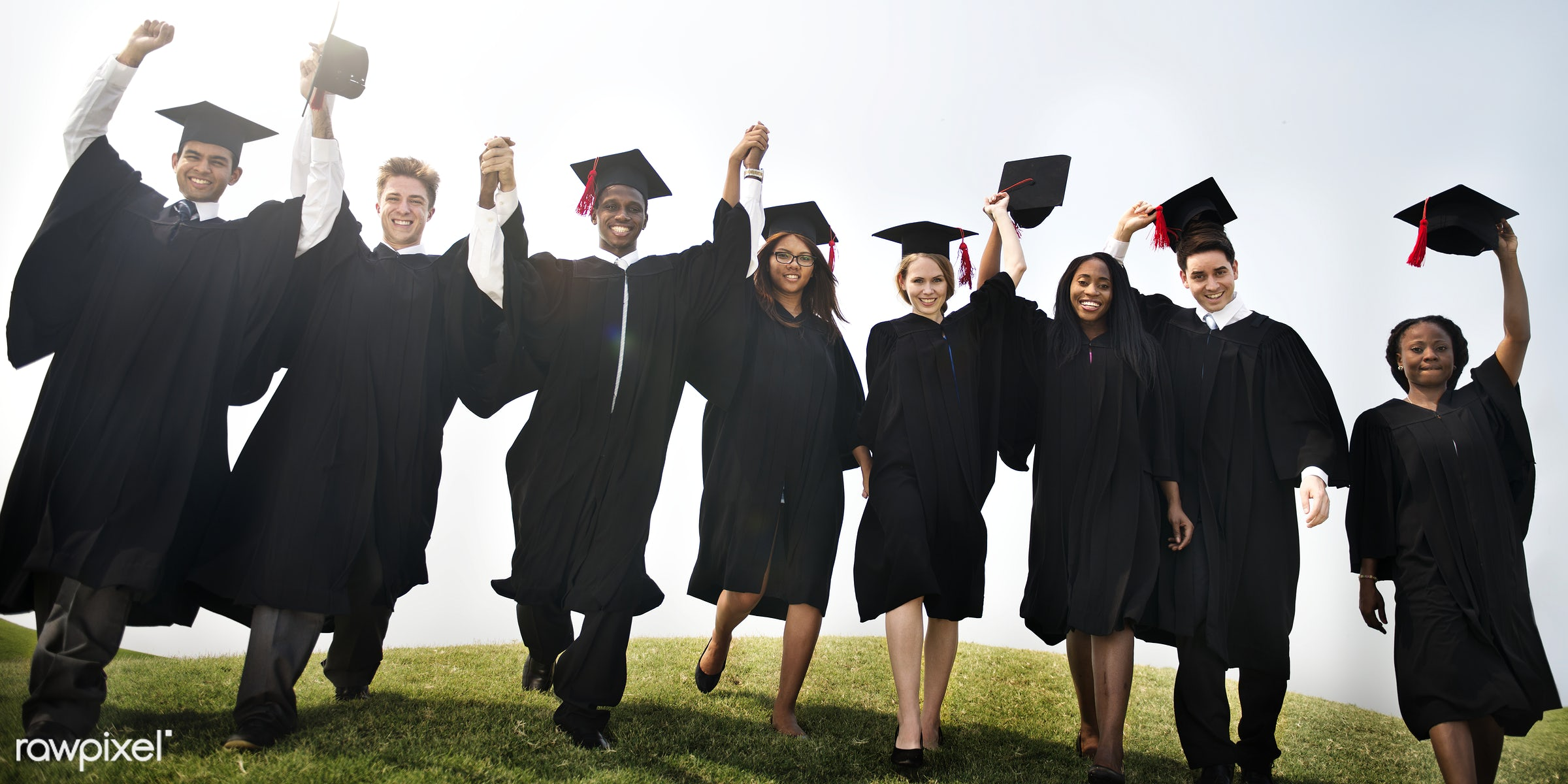 Group of diverse graduating students - certificate, academic, achievement, african descent, asian ethnicity, campus,...