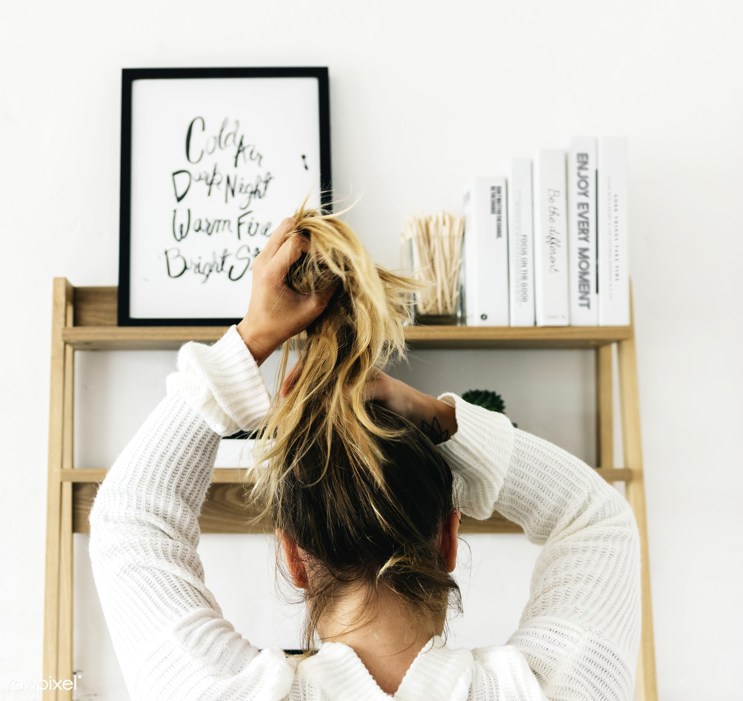 Rear View of a Woman Tying Her Hair Up - desk, winter, cold, brunette, casual, hairstyle, home, lifestyle, long hair, rear...