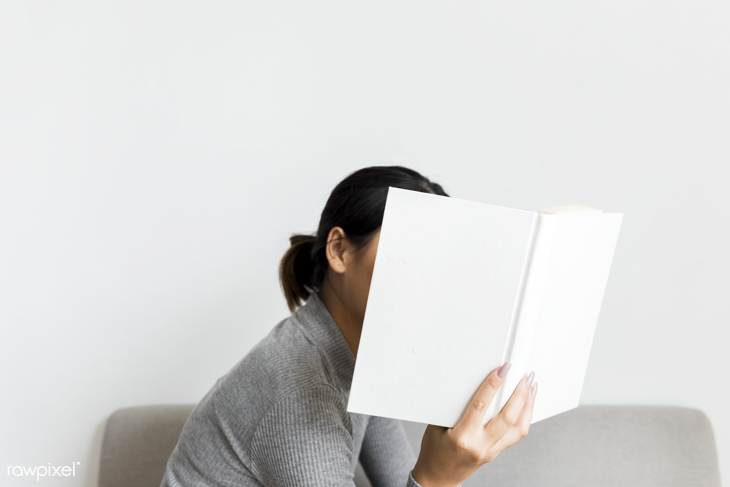 An Asian Woman Reading a Book - minimal, bedroom, asian, book, casual, cold, day, diary, female, hobby, home, lady, leisure...