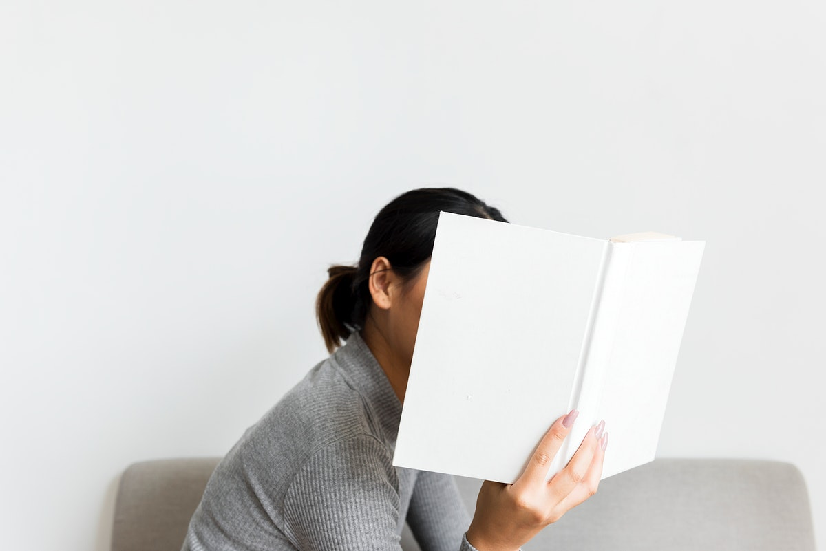 An Asian Woman Reading a Book