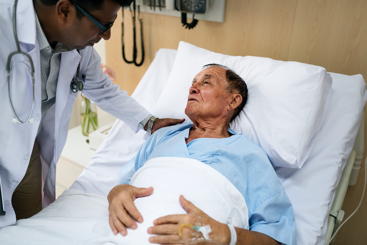 A sick elderly is staying at the hospital