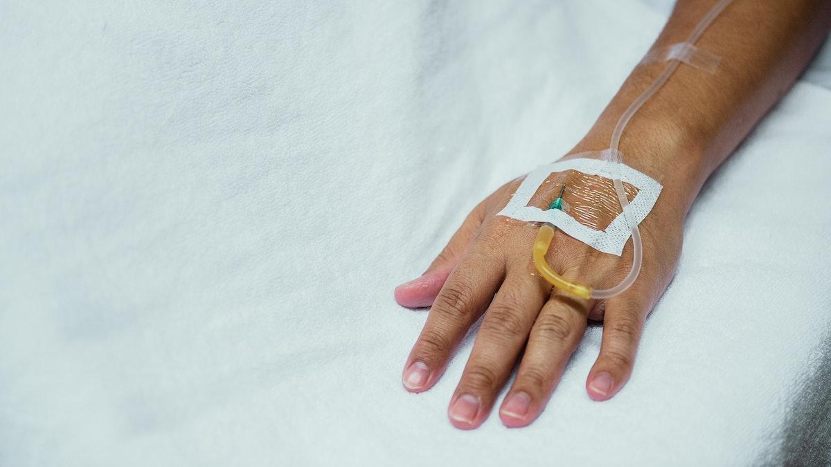 IV drip in a coronavirus patients hand