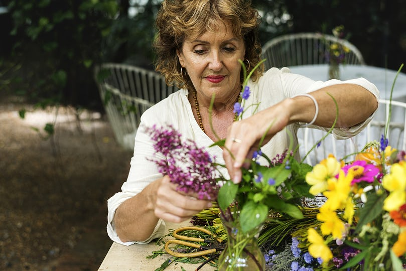 Woman arranging some flowers