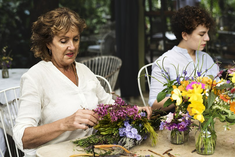 Women arranging flowers