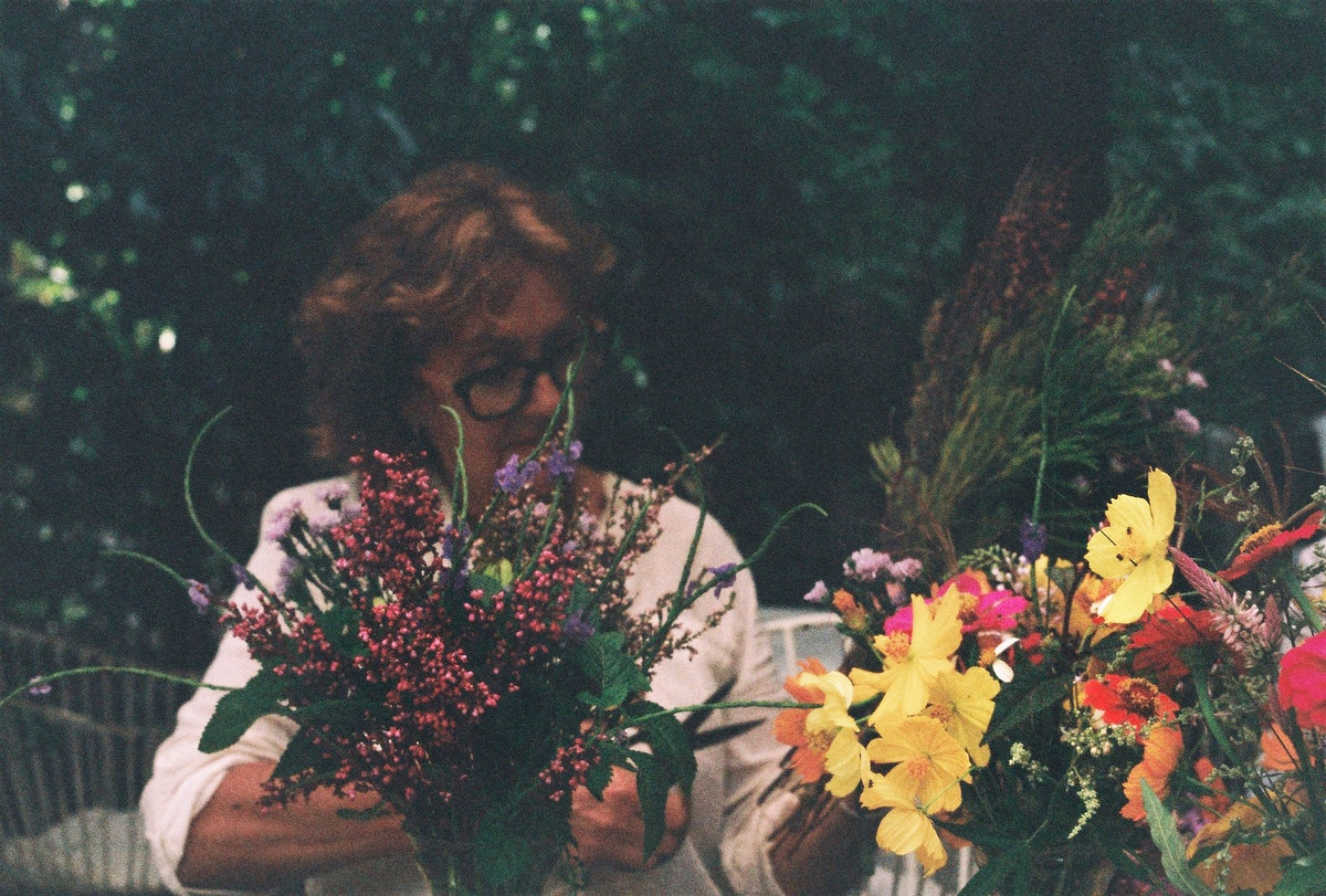 Woman arranging and decorating flowers