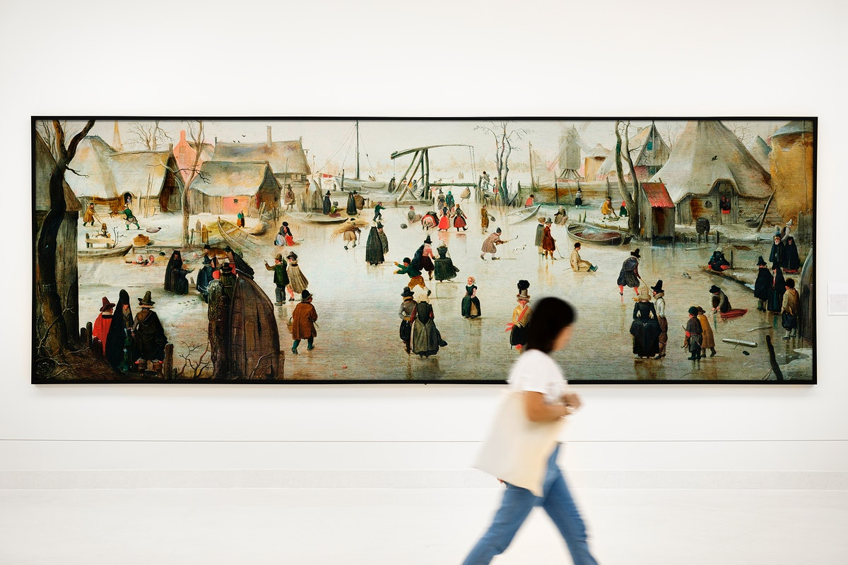 Girl walking by a big painting on the wall