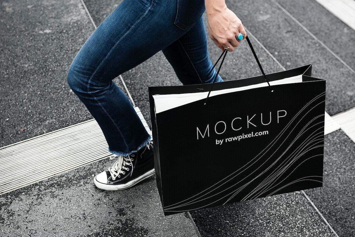 Woman carrying a shopping bag mockup