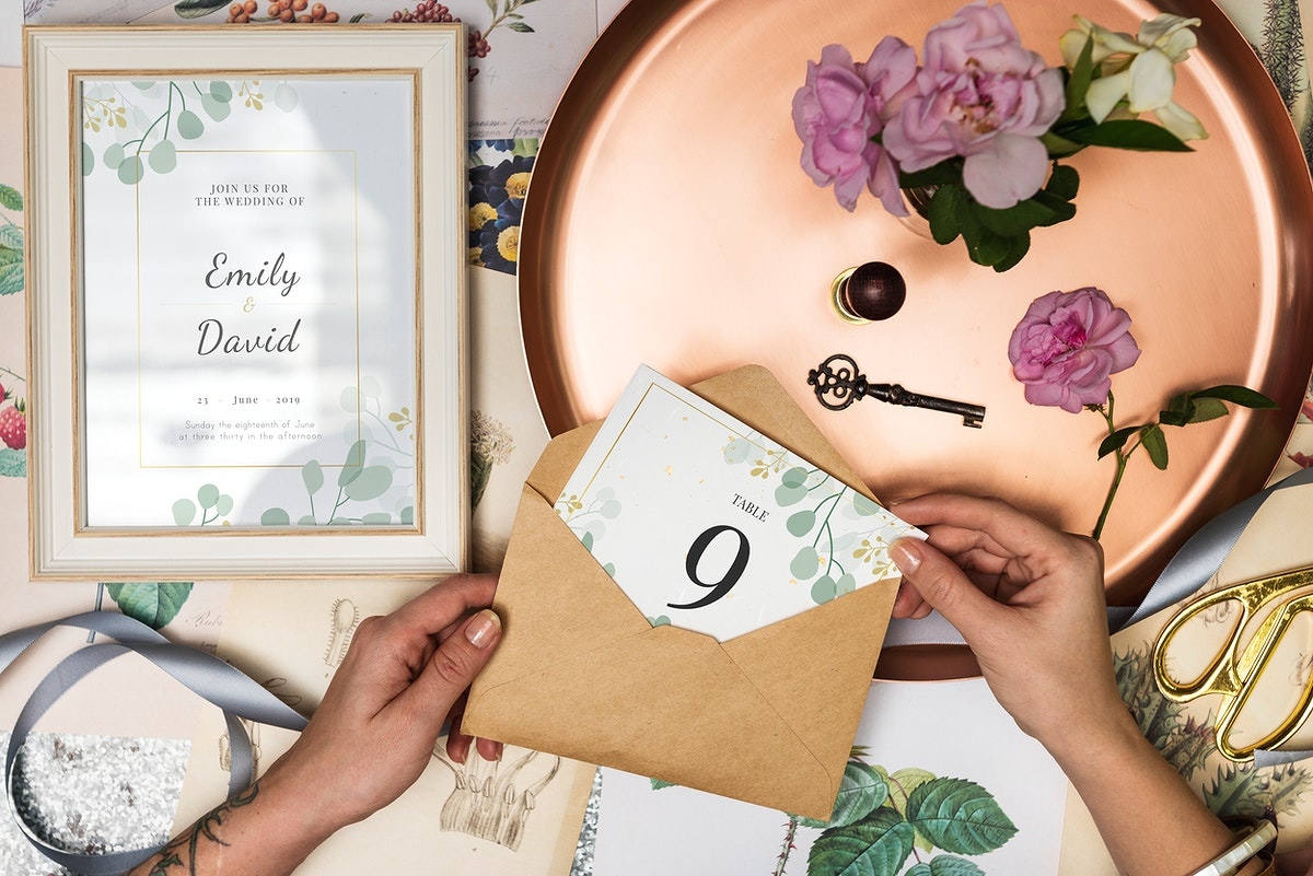 Hand holding a wedding table card