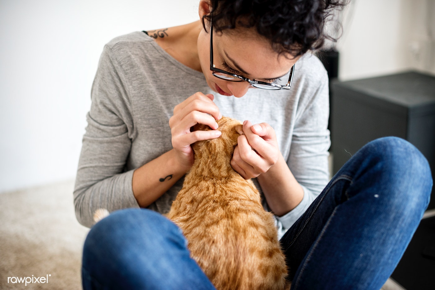 Woman petting a cat in a living room
