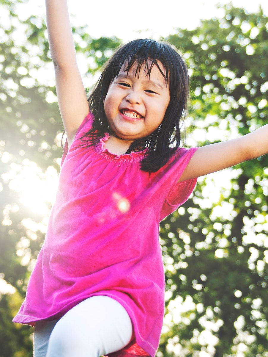 Little Asian girl playing in the park