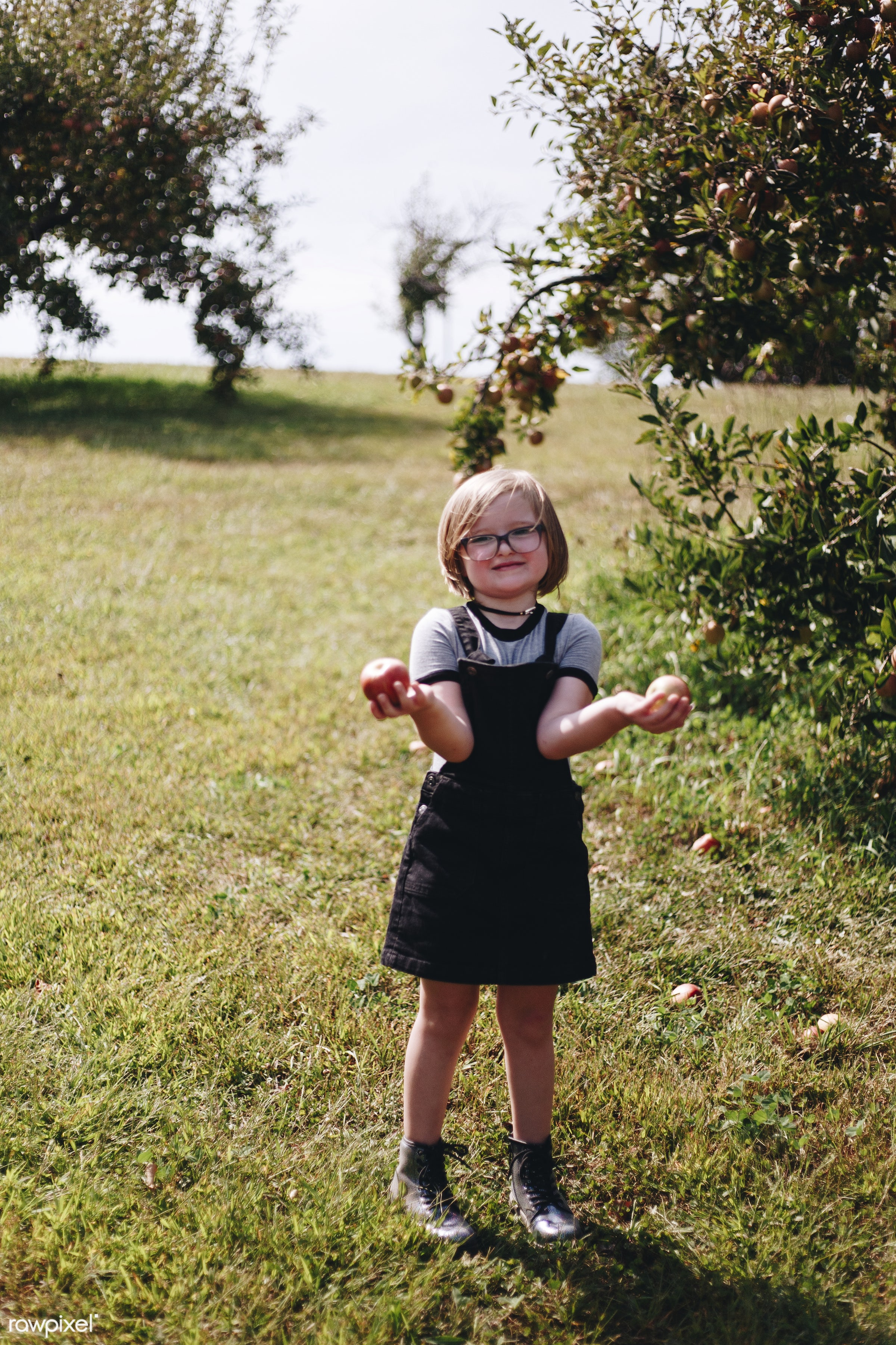 A young girl is having fun in the farm - alone, america, american, canada, canadian, caucasian, cheerful, child, countryside...
