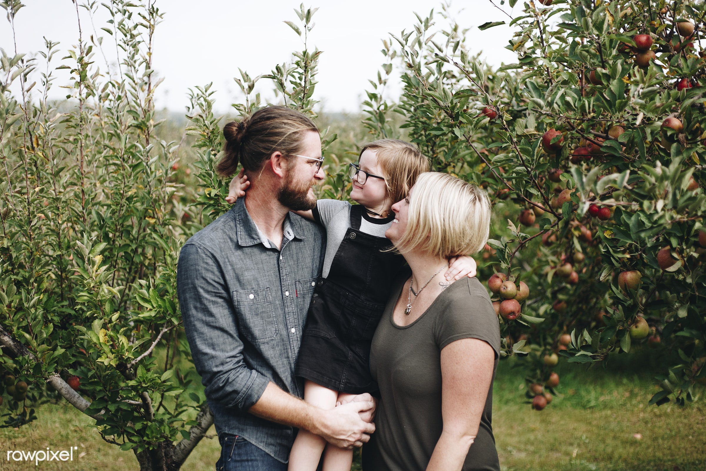 A Caucasian family is spending time at the farm together - family, parent, canada, mom, love, countryside, apple, fruit,...