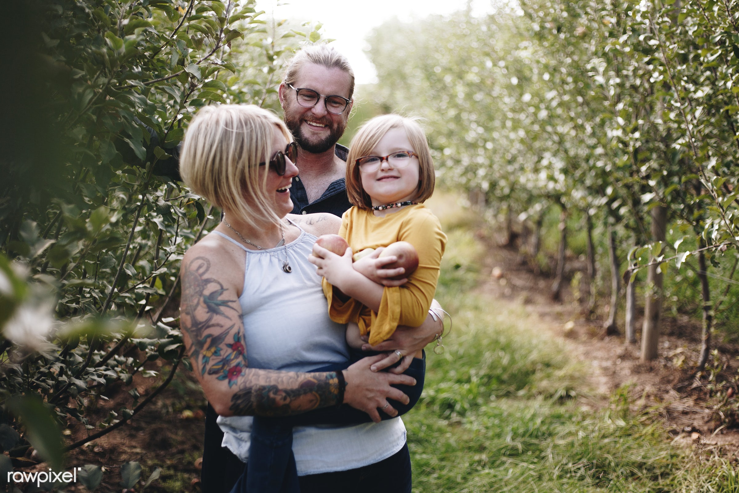 A Caucasian family is spending time at the farm together - family, kid, mother, america, american, apple, apples, canada,...