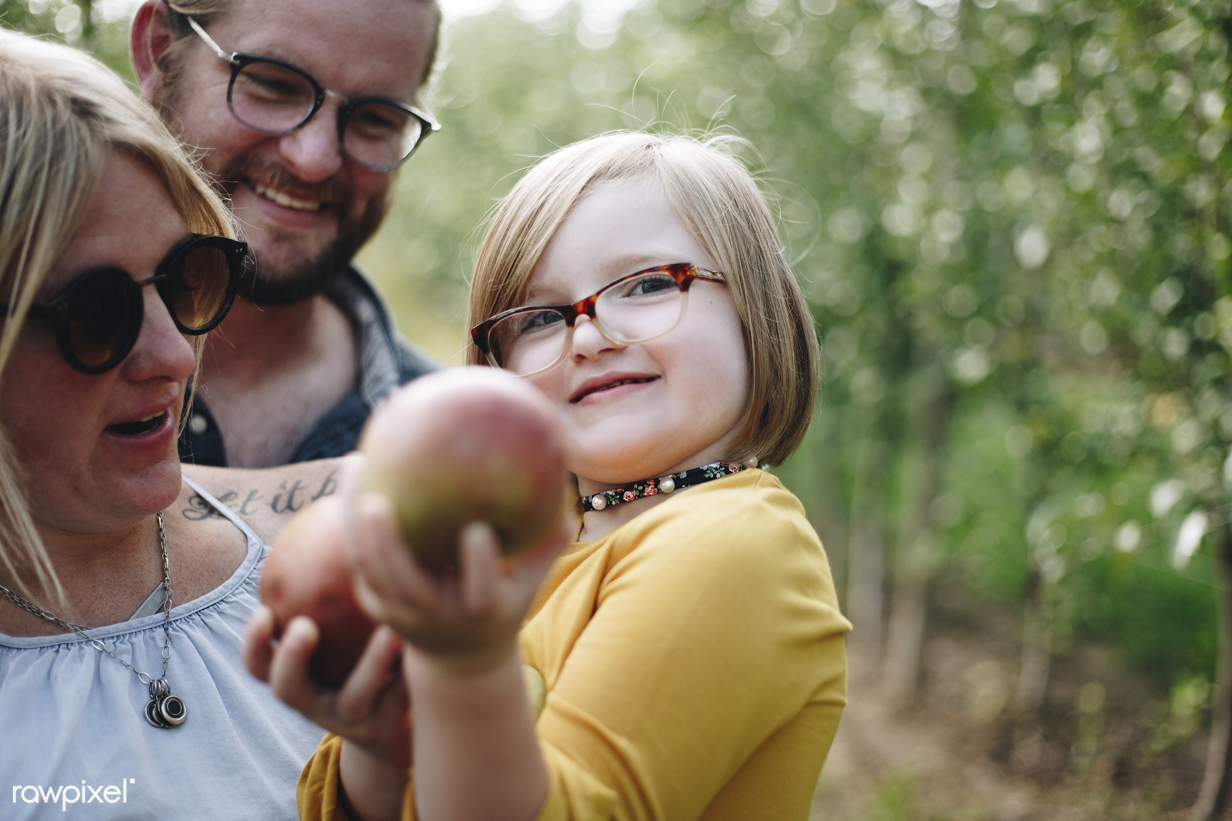 A Caucasian family is spending time at the farm together - america, american, apple, apples, canada, canadian, caucasian,...