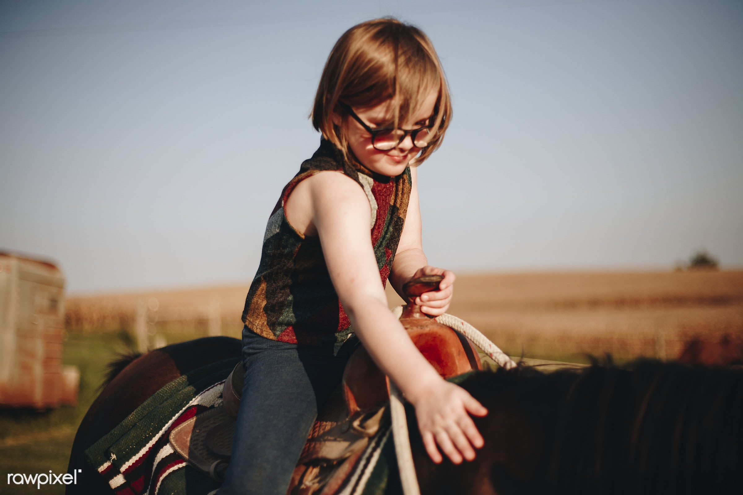 Little girl riding a horse - horse riding, activity, america, american, animal, canada, canadian, child, countryside,...