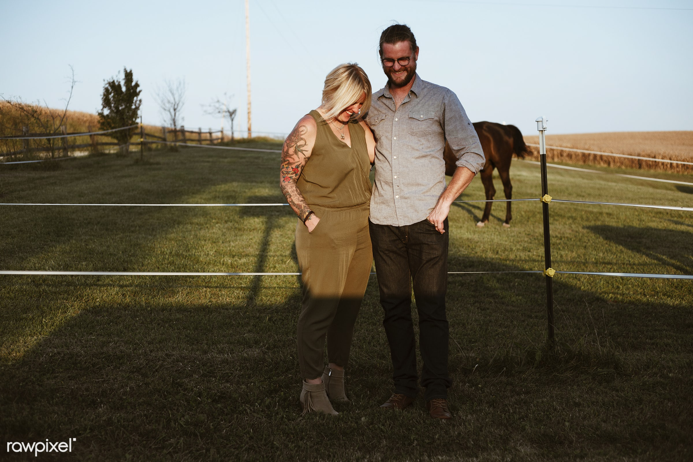 Happy caucasian couple in a farm - america, american, canada, canadian, cares, cheerful, countryside, couple, european,...