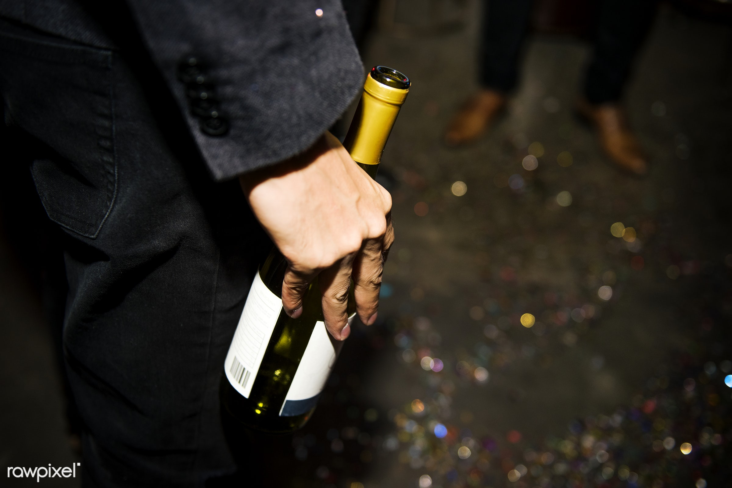Closeup of hand holding champagne bottle - 2018, alcohol, alone, birthday, birthday party, bottle, celebrate, celebration,...