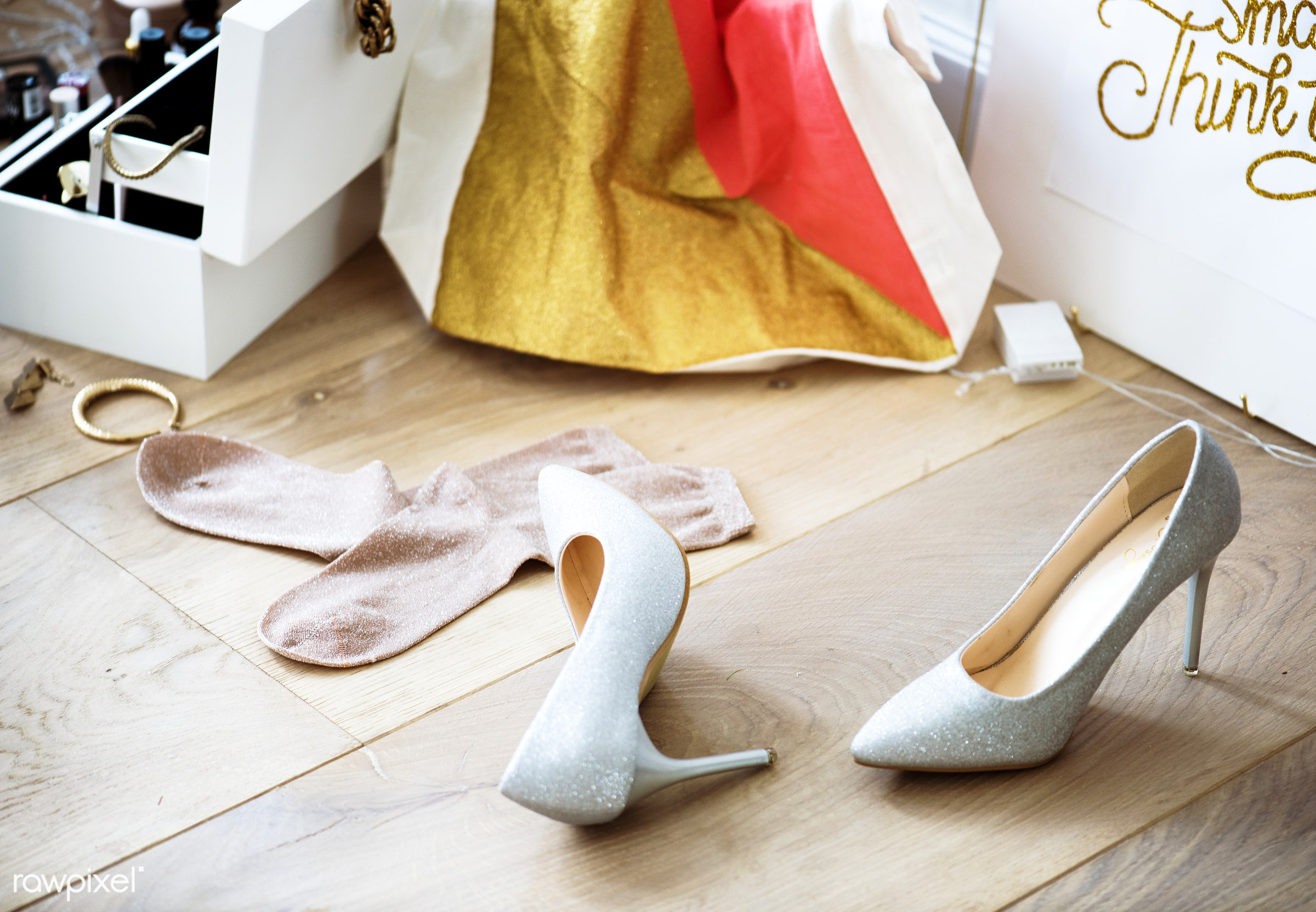Closeup of heels lying on the wooden floor - woman, dress up, 2018, after party, closeup, cosmetics box, feminine, floors,...