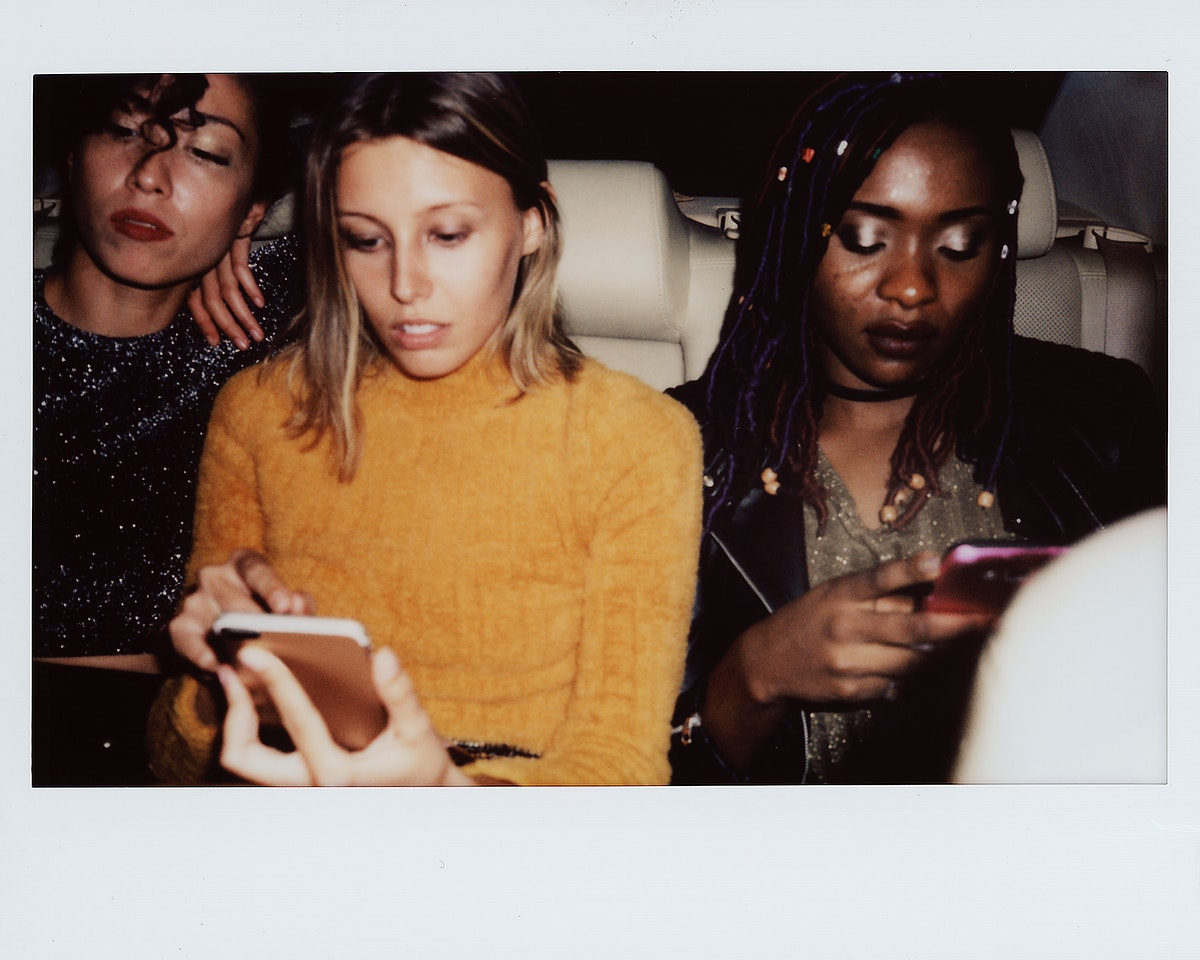 Diverse women in a backseat of a cab