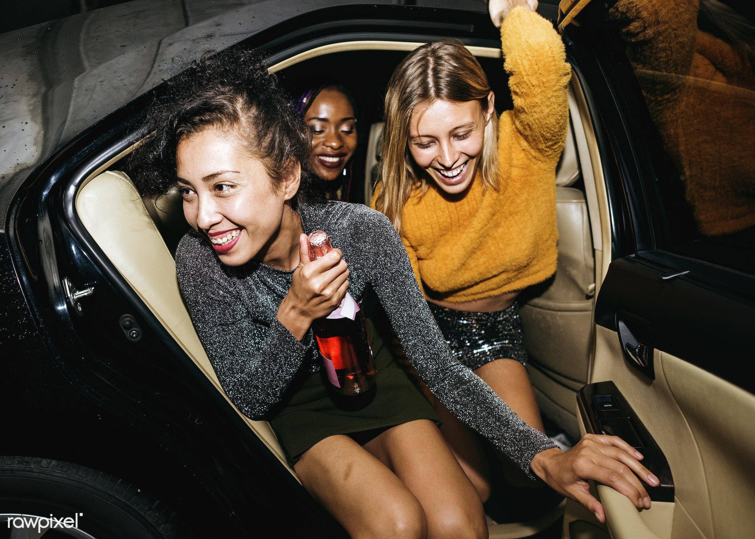 Diverse women in a backseat of a cab - 2018, african american, african descent, arrive, backseat, beverage, black, bottle,...