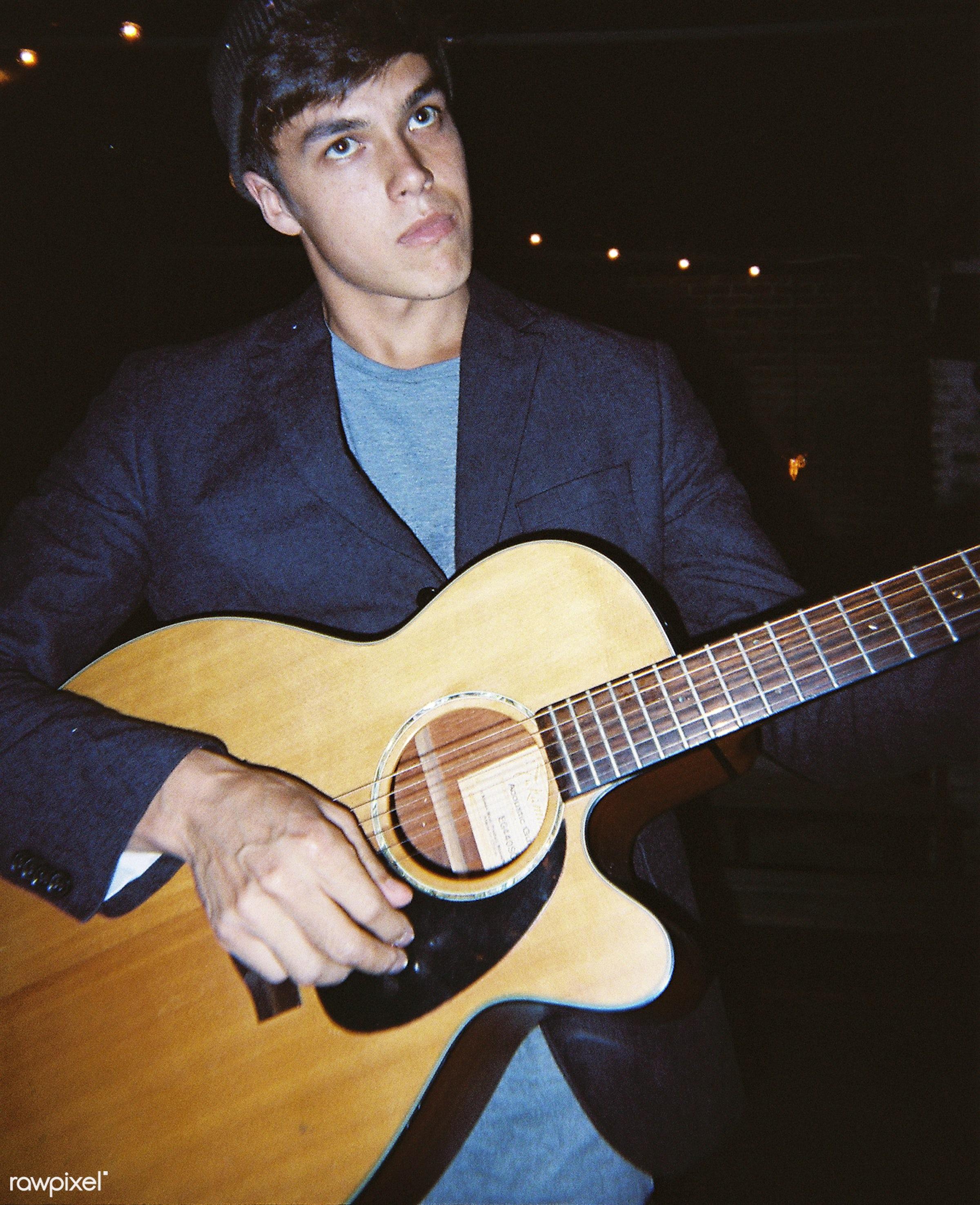 A man playing guitar - 2018, alone, band, birthday, birthday party, caucasian, celebrate, celebration, entertainment, fun,...