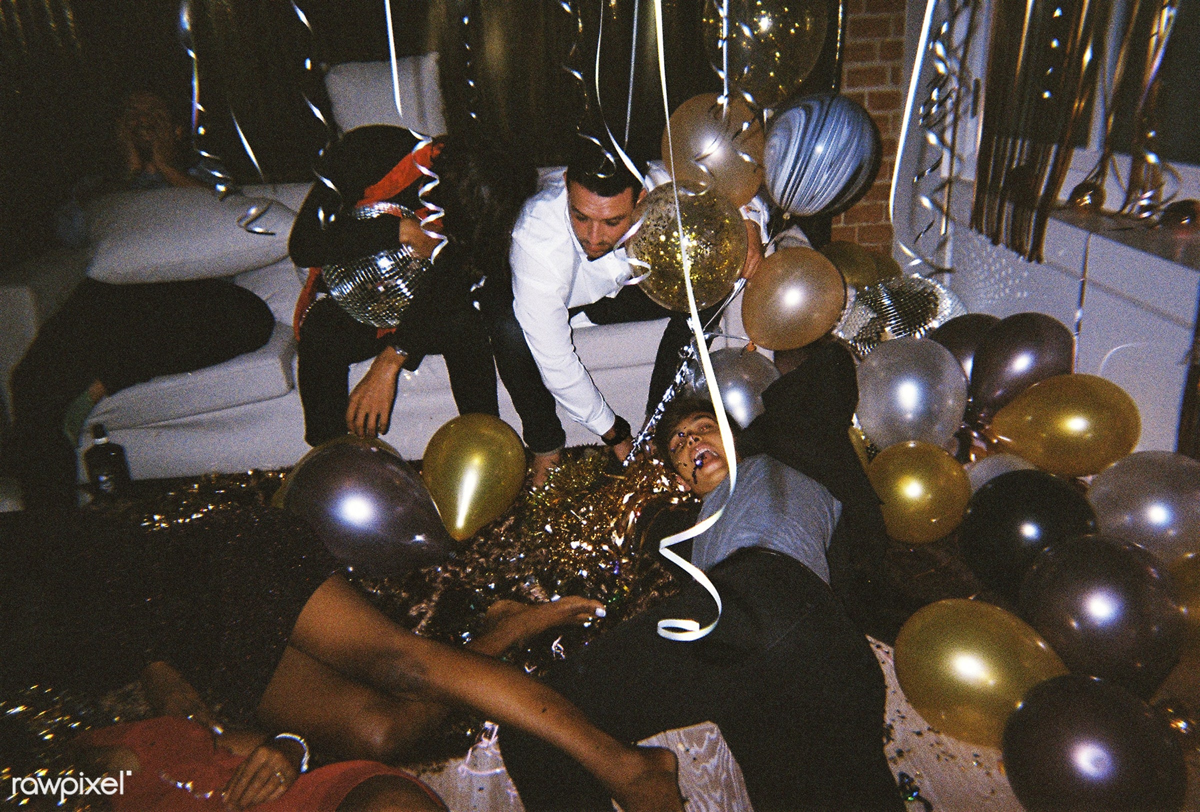 People enjoying a party with friends - new year, party, 2018, african american, african descent, balloons, birthday,...