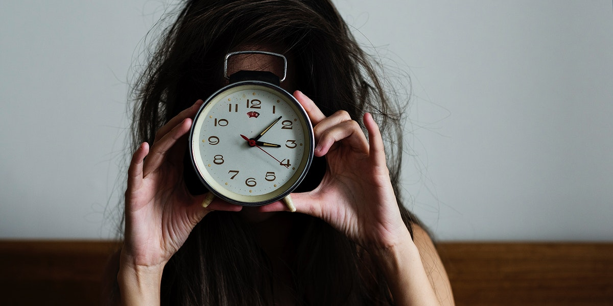 Messy hair girl wakes up with a clock social banner