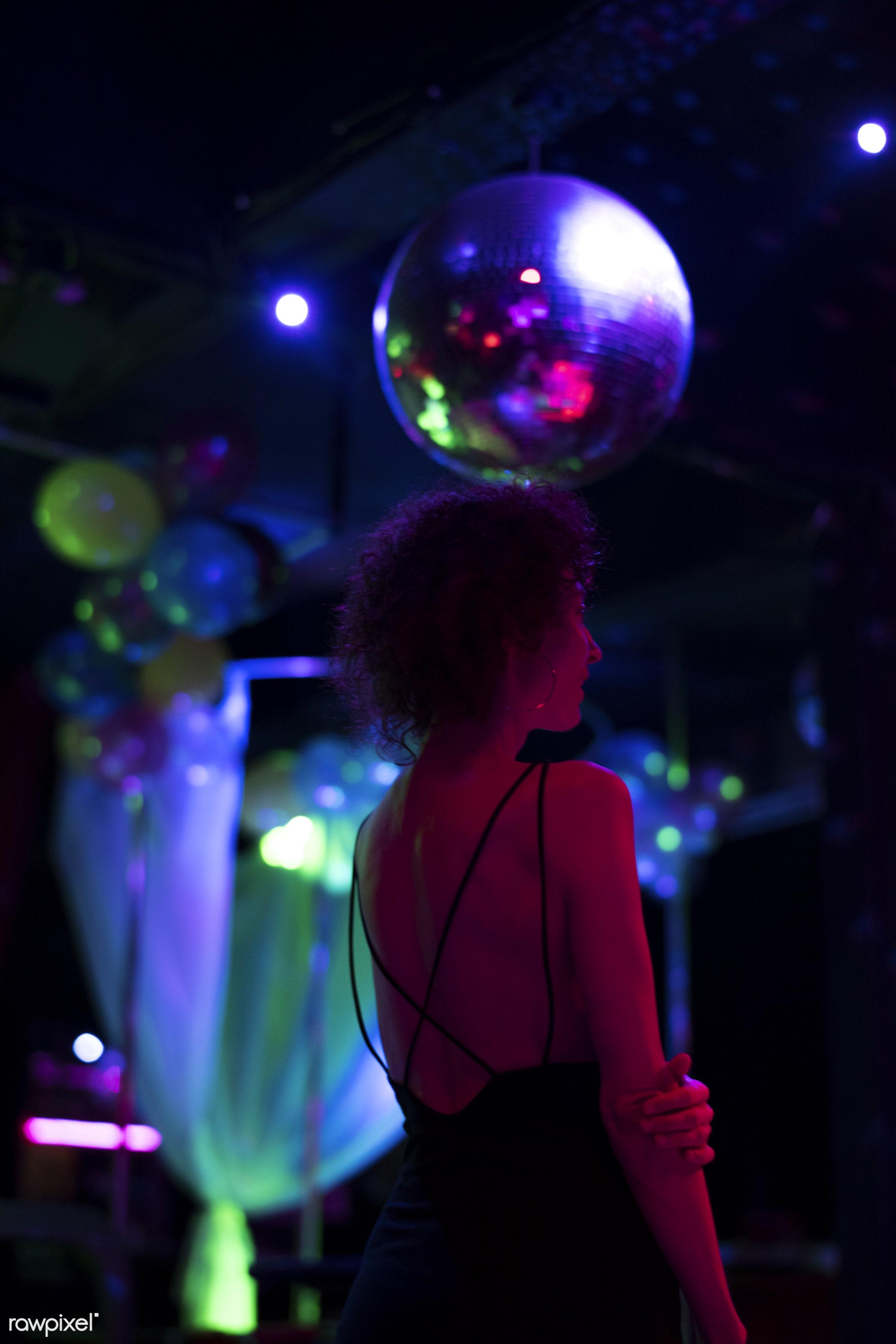 Woman on the dance floor of a club - night, alone, balloons, bar, celebration, club, clubbing, curly hair, dance floor,...