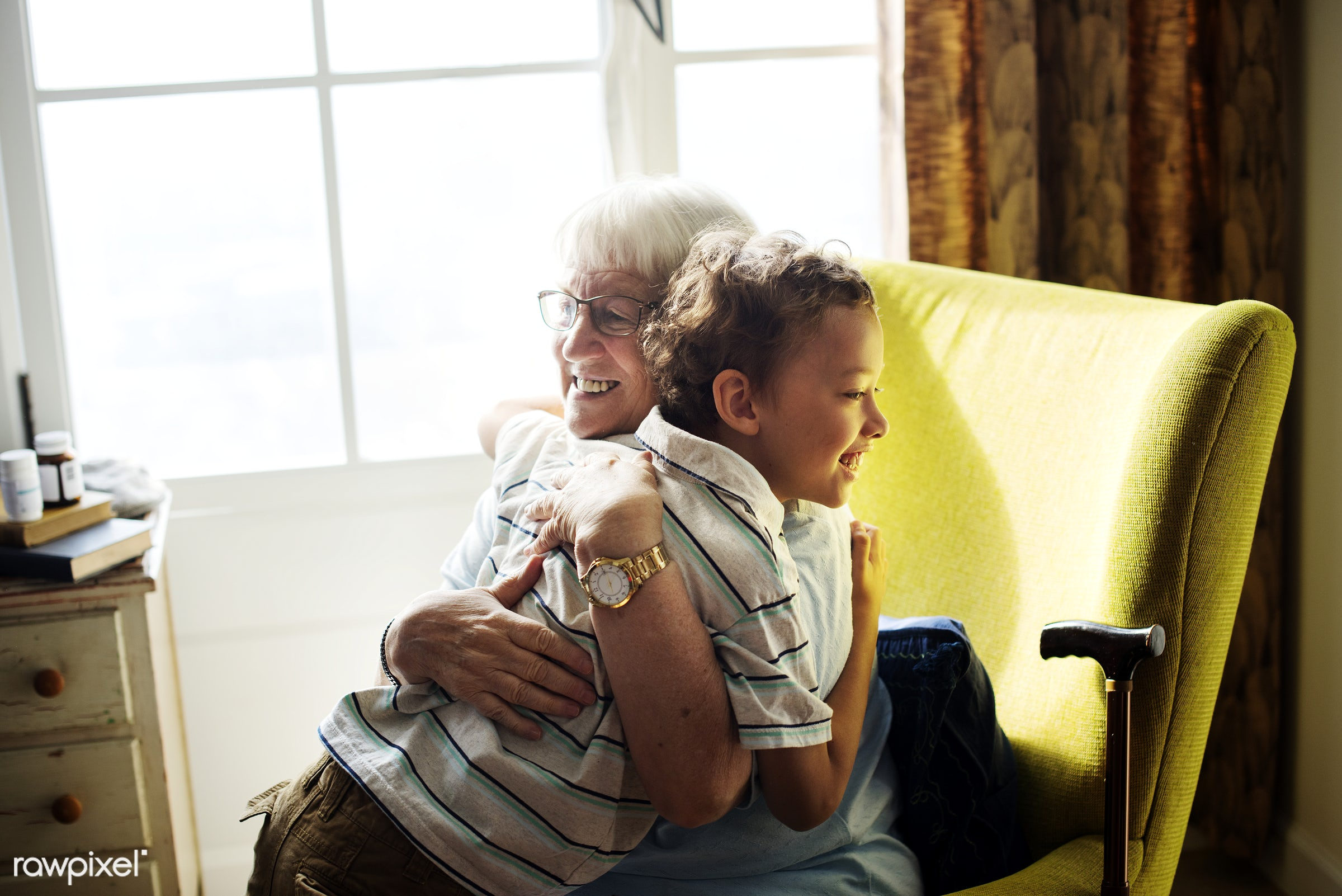 Grandma and grandson hugging together - aging, american, boy, caucasian, child, children, elderly, embracing, european,...