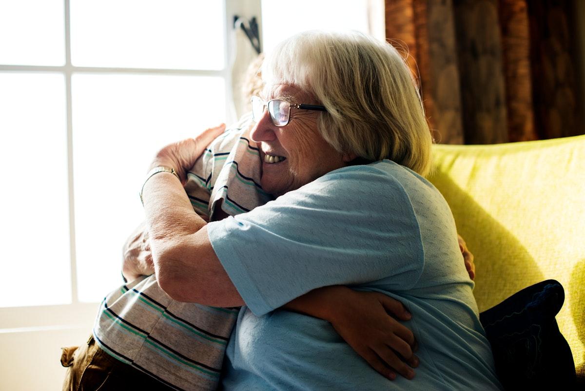 Grandma and grandson hugging together
