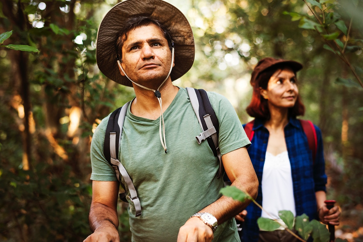 Couple trekking together in a forest