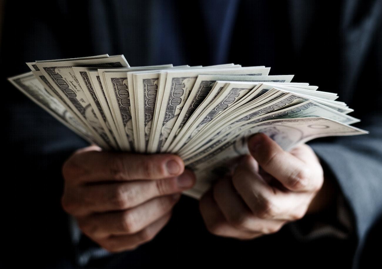Closeup of hands holding cash