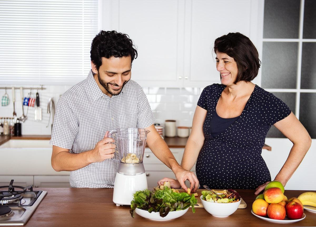 Caucasian couple making fresh smoothie
