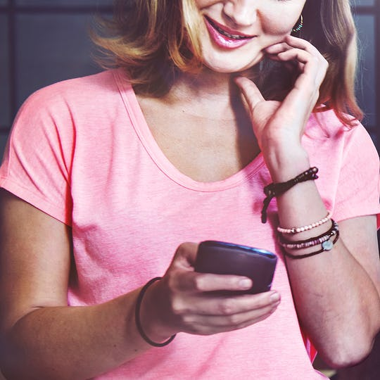 Caucasian woman is using mobile phone
