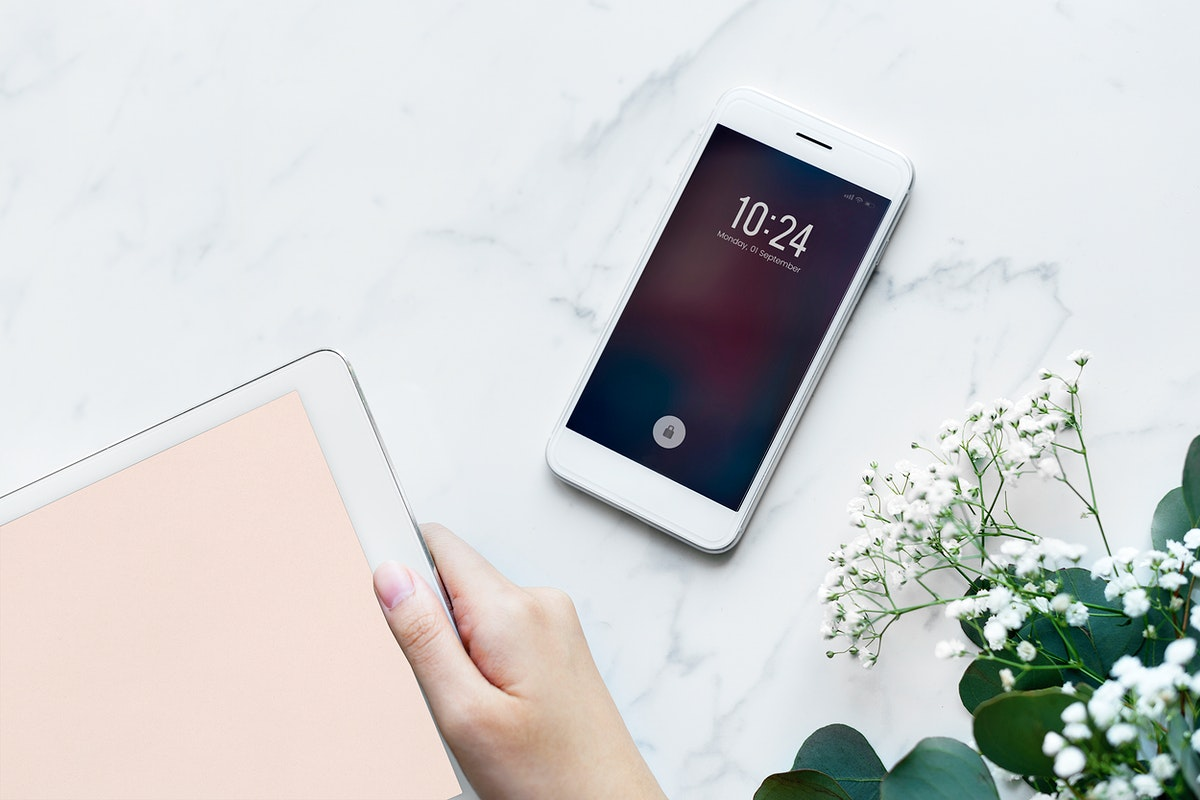 Woman using digital tablet and smartphone feminine and girly concept