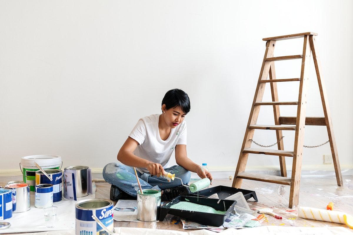 Woman renovating the house
