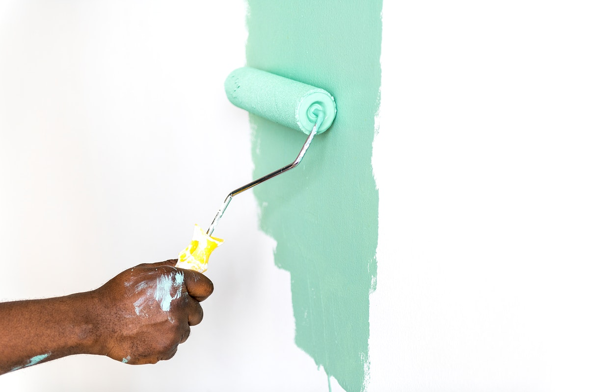 People painting house wall for interior design