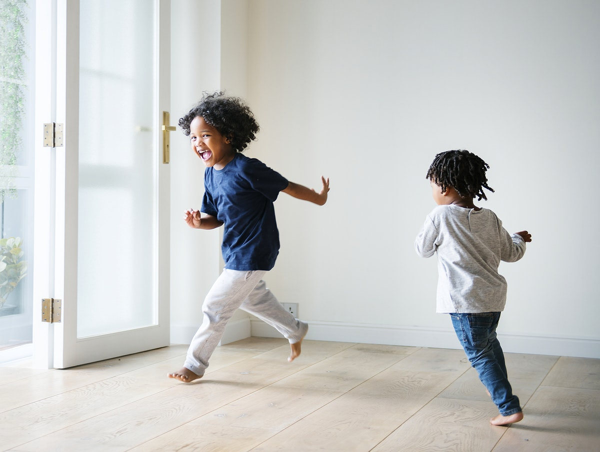 Young black boys playing in their new house