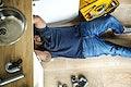 Man fixing kitchen sink