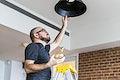 Man changing light bulb