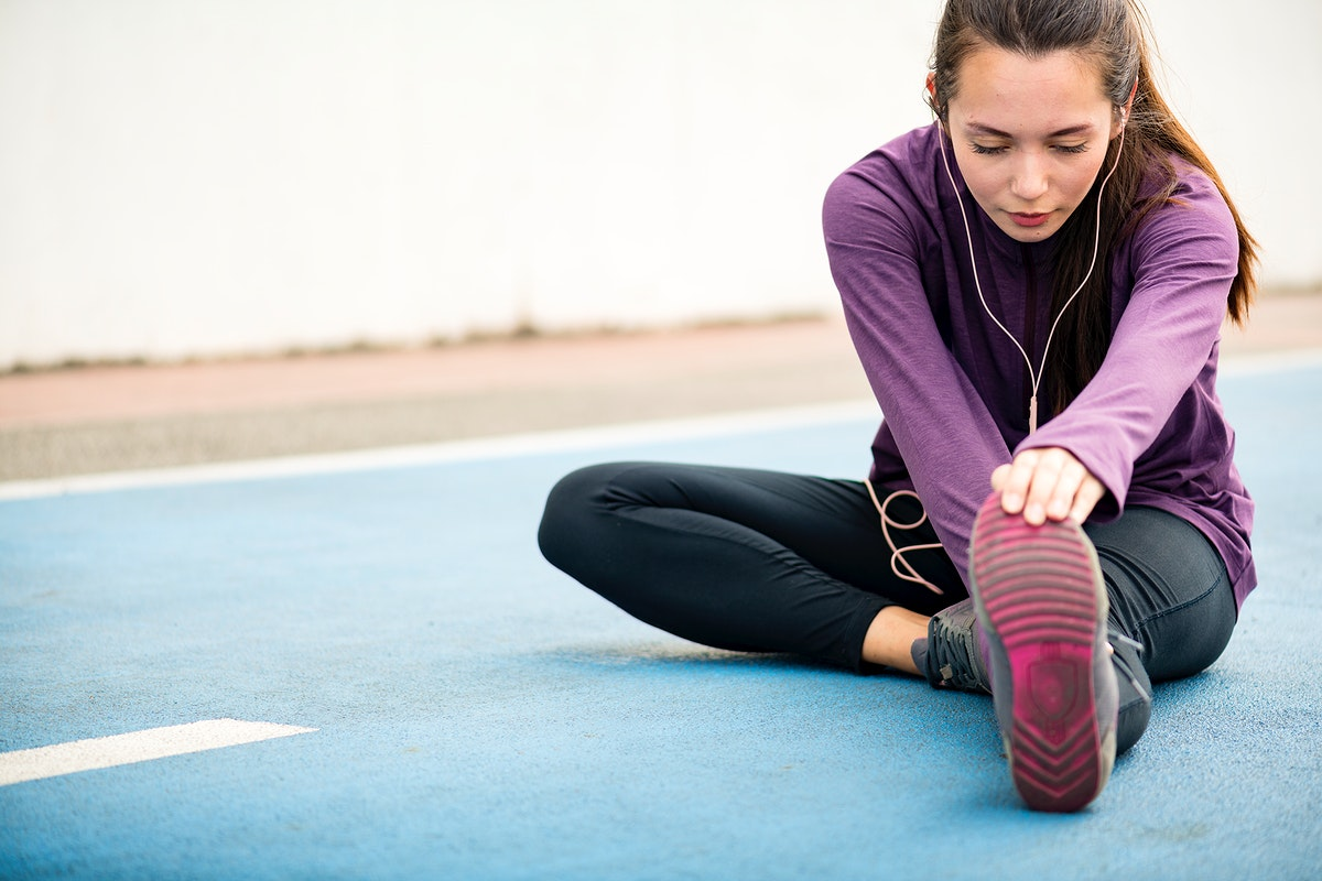 Woman stretching before exercise